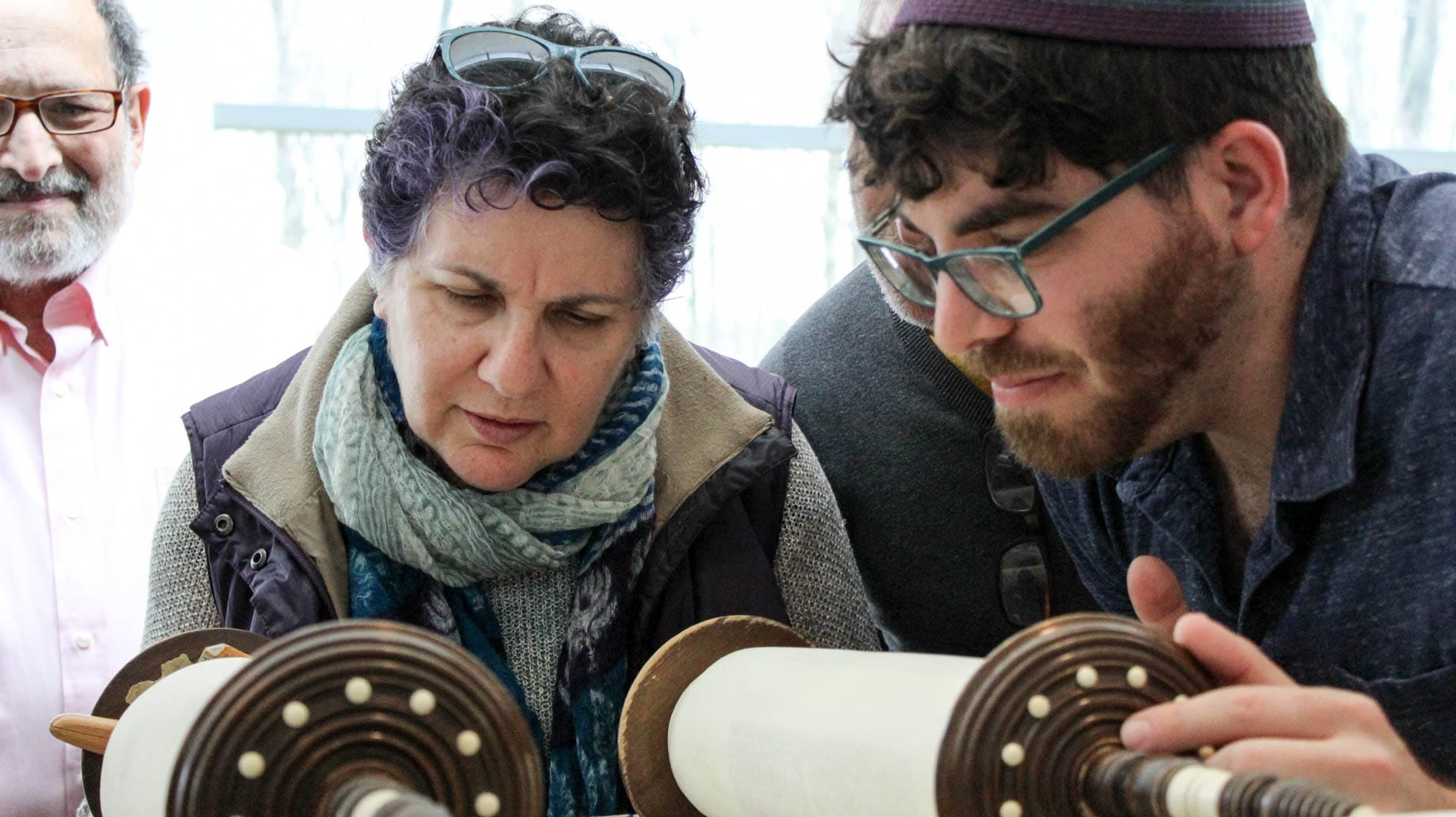 rabbinical students reading the torah