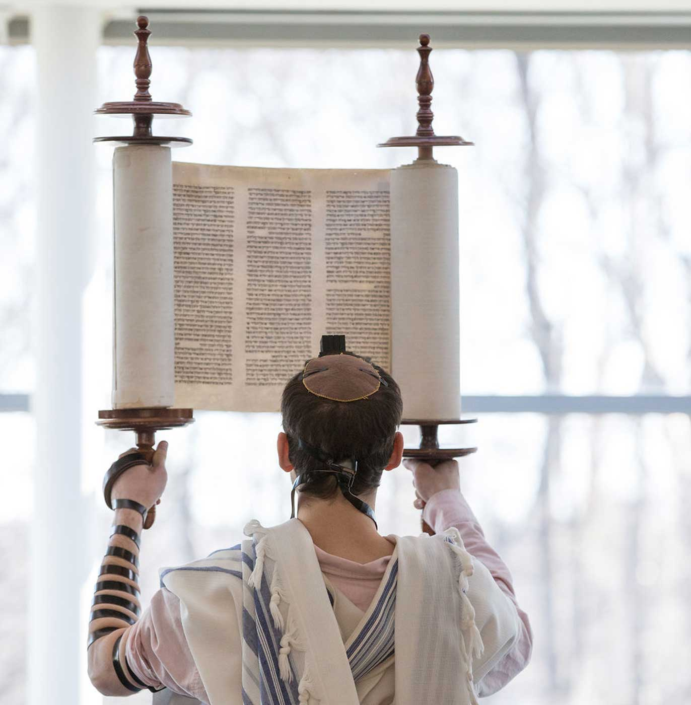 student holding up torah