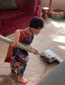 little boy vacuuming
