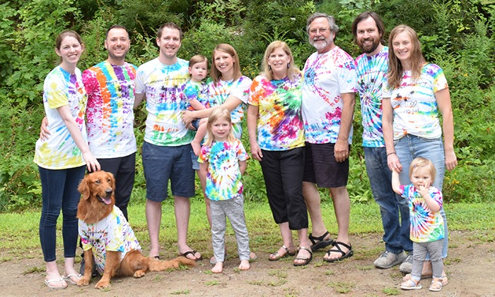 multi-genreational family picture with everyone wearing tie-dye t-shirts