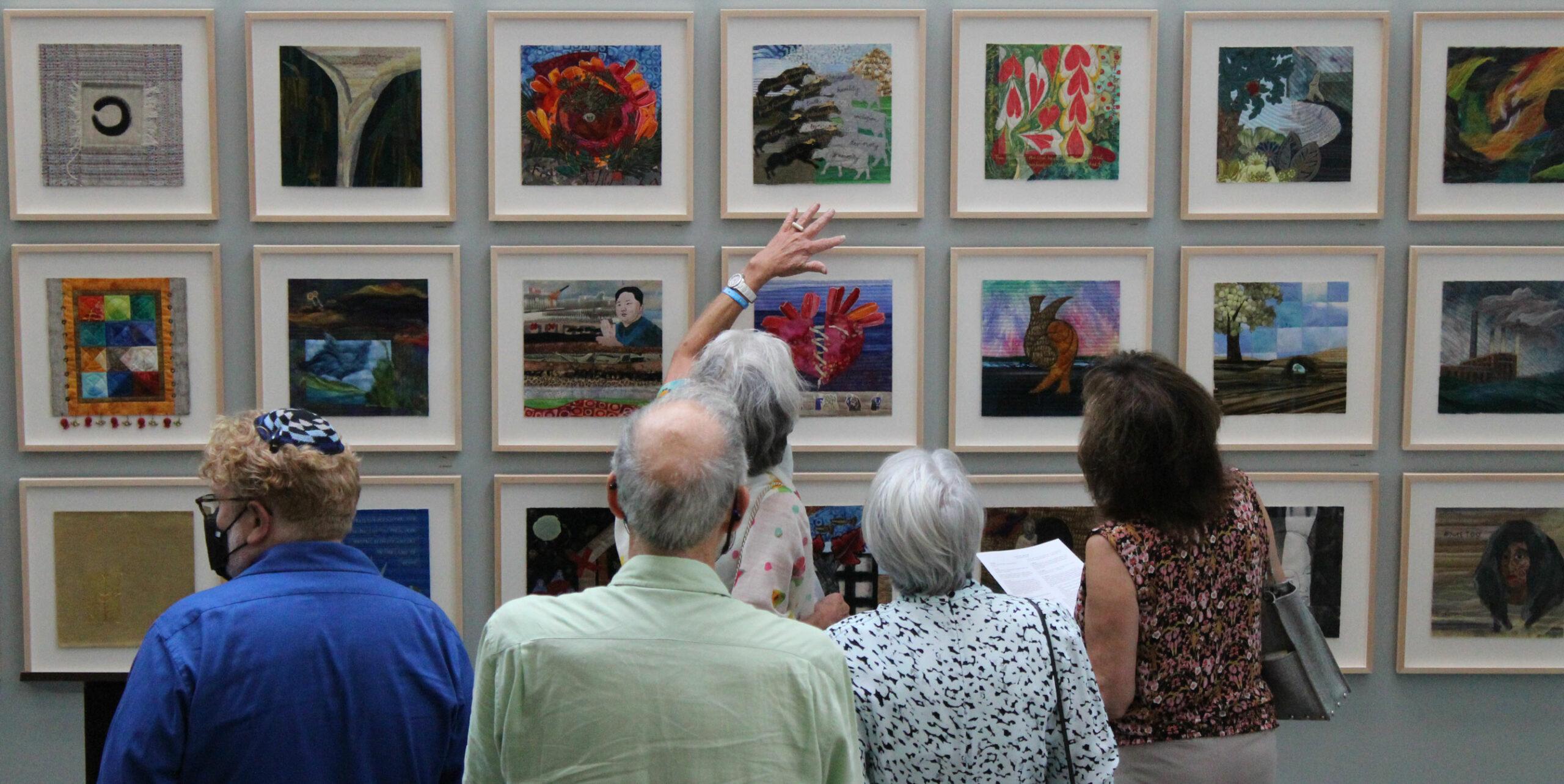 people viewing art exhibit