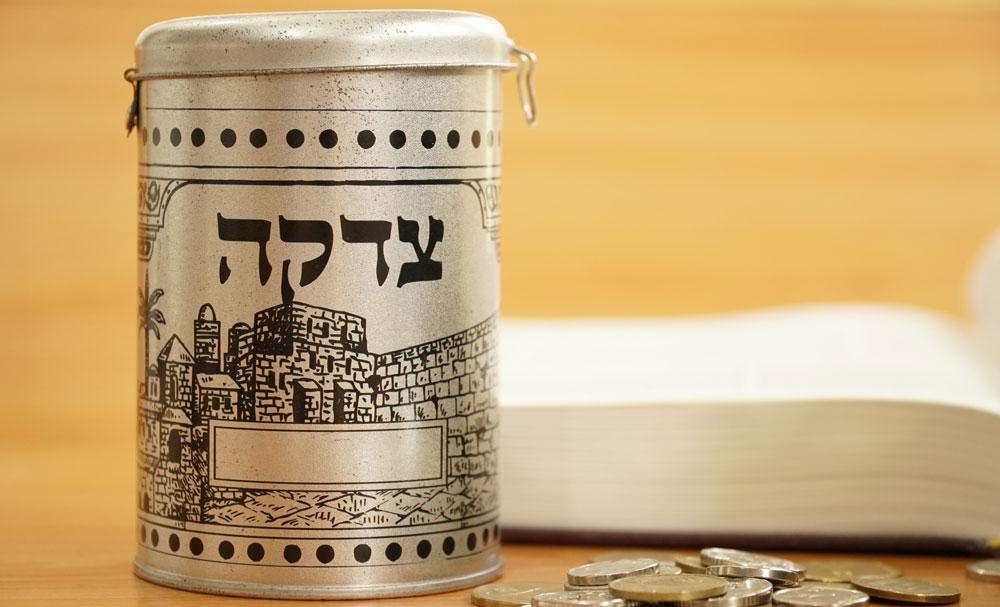 Tzedakah-box-and-coins